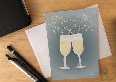 champagne flutes with bubbles rising out and forming a heart on teal gray background