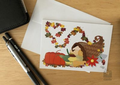 Thanksgiving Cornucopia with Autum Leaves swirling into Heart
